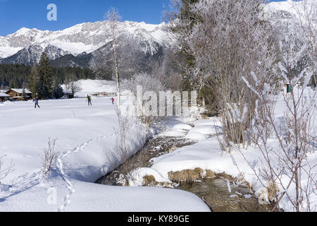 Winter mountain landscape with stream and birches trees covered with hoarfrost - Stock Photo