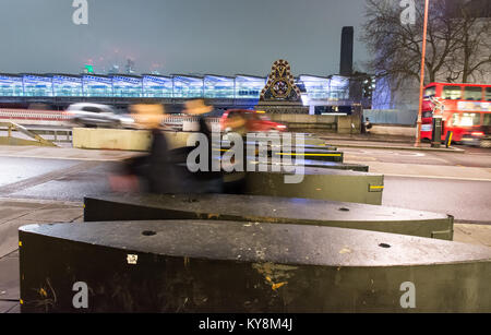 London, England, UK - January 11, 2018: Pedestrians walk through security barriers on Blackfriars Bridge in central - Stock Photo