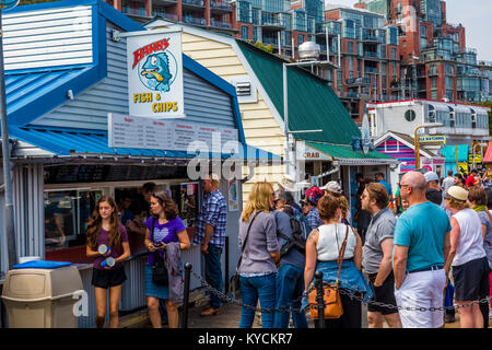 Barb's Fish & Chips on Fisherman's Wharf in Victoria Canada a tourist attraction with food kiosks, unique shops - Stock Photo