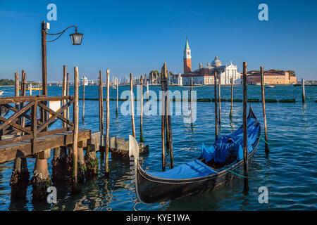 Parked gondolas and the Church of San Giorgio Maggiore in Veneto, Venice, Italy, Europe, - Stock Photo