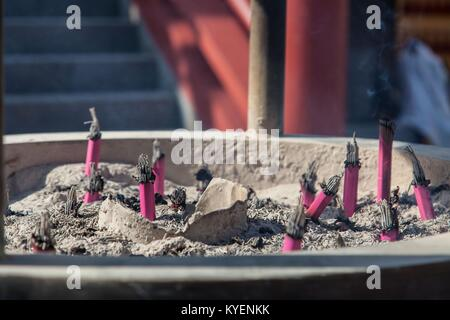 Close-up of the remains of burnt offerings at the Bentendo Temple in Ueno Park, Ueno District, Taito, Tokyo, Japan, - Stock Photo