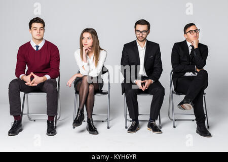 Business people waiting for job interview isolated on white - Stock Photo