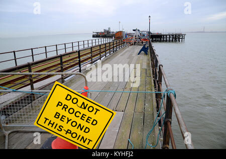 Repair work underway on Southend Pier after it was hit by a barge in bad weather. Do not proceed beyond this point - Stock Photo