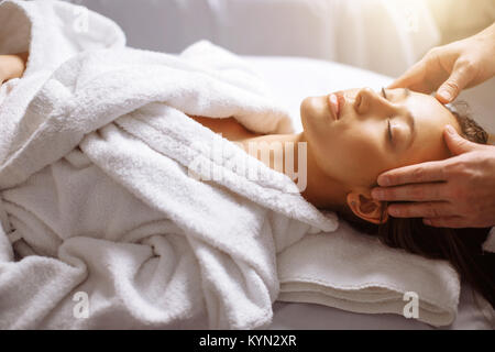 girl having spa facial massage in luxurious beauty salon - Stock Photo