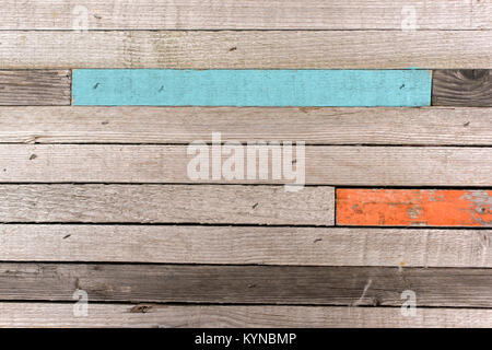Part of old wooden panel with different colour timber - Stock Photo