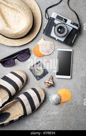 Travel accessories on gray stone background - Stock Photo