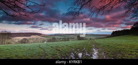View at a winter sunset towards Butser Hill and the South Downs from near Old Winchester Hill - Stock Photo