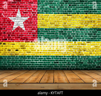 Togo flag painted on brick wall with wooden floor - Stock Photo