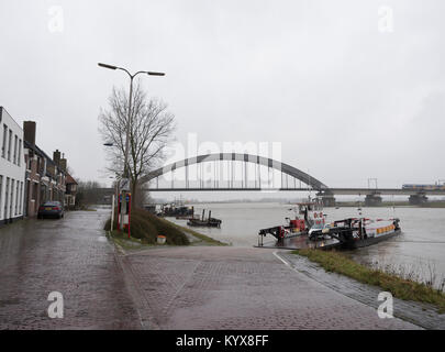 bridge and ferry on river lek near dutch town of Culemborg in the netherlands - Stock Photo