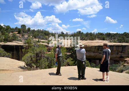 park rangers giving information to tourists at Mesa Verde National Park colorado USA - Stock Photo