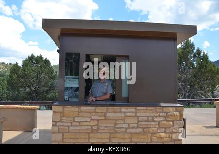 park ranger in the entrance booth to Mesa Verde National Park colorado USA - Stock Photo