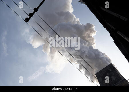 The concept of problems related to environmental pollution. Smoking chimney in a factory - Stock Photo