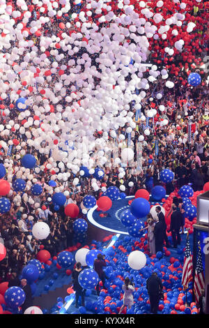 red white and blue balloons confetti falling on delegates / Hillary Clinton / Bill Clinton / Tim Kaine at the 2016 - Stock Photo