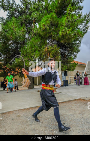 Arsos Village, Cyprus - October 8, 2017: Man dressed in traditional clothing performing folk dance, thrapani, holdng - Stock Photo