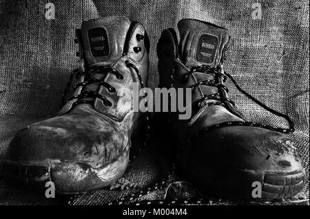 Das Boots. A pair of old work boots - Stock Photo