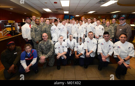 Food services personnel from the 28th Force Support Squadron stand together during a group - Stock Photo