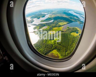 View through the porthole of aircraft. Fisheye image. - Stock Photo