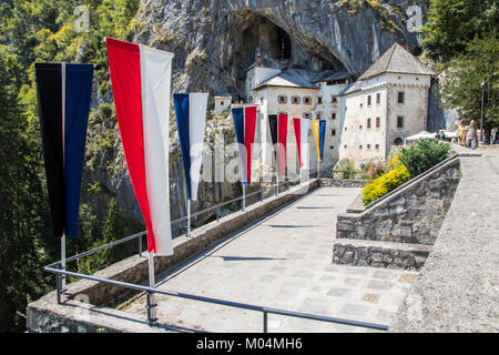 Predjama Castle (Predjamski grad), a Renaissance castle built within a cave mouth in the historical region of Inner - Stock Photo