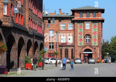 KATOWICE, POLAND - SEPTEMBER 5, 2014: People visit Nikiszowiec historic district in Katowice, Poland. With 304 thousand - Stock Photo
