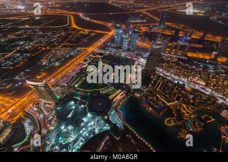 View over the city from Burj Khalifa, Dubai, United Arab Emirates - Stock Photo