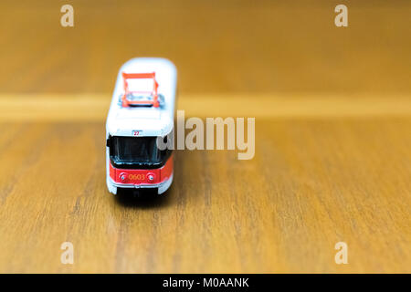 old toy tram on a wooden background - Stock Photo