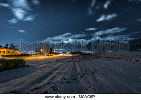 Somewhere out there in the fields by quiet Mountain Roads observing the colourful Lights. - Stock Photo