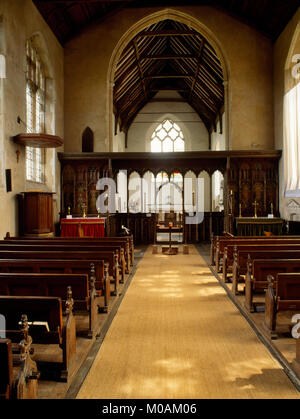 Nave of St Helen's Church, Ranworth, late C15th painted rood screen with north (L) & south (R) side altars, & high - Stock Photo