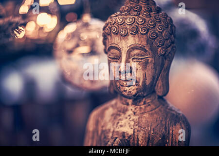 Vintage style photo of the wooden statue of Buddha, God of oriental religion, conceptual picture of meditation, - Stock Photo