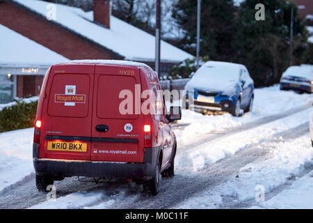 royalmail postal delivery van driving along street covered in snow in newtownabbey northern ireland - Stock Photo