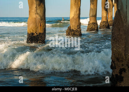 Early morning surfing at Manhattan Beach pier in Los Angeles County, California. (USA) - Stock Photo
