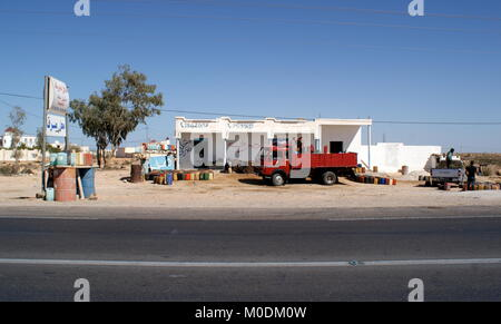 Contraband petrol smuggled from Libya for sale on southern Tunisian roadside - Stock Photo