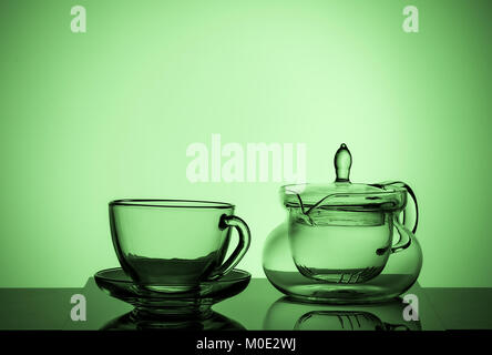 Set of different glass dishes, cup and teapot - Stock Photo