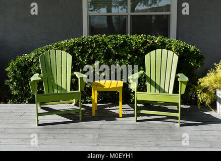 Two Adirondack chairs on a deck - Stock Photo