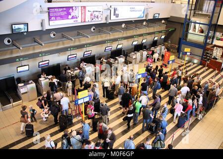 KATOWICE, POLAND - SEPTEMBER 1: Travelers wait for check-in on September 1, 2009 at Katowice Airport, Poland. With - Stock Photo