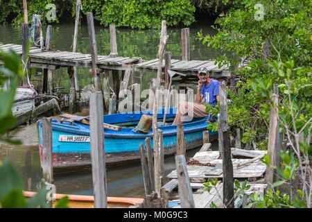 Fisherman in Cojimar fishing village, Cuba - Stock Photo