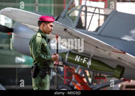 Guard in front of Cuban bomber plane at the Memorial Granma in Havana, Cuba - Stock Photo