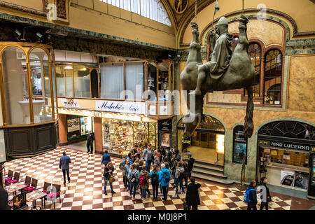 Statue of King Wenceslas Riding an Upside-Down Dead Horse by Prague artist David Cerny in the Lucerna Palace Gallery - Stock Photo