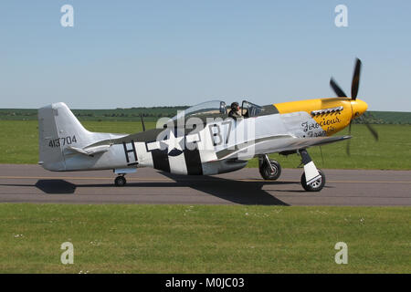 North American P-51D Mustang flown by the Old Flying Machine Company taxiing out at Duxford during a air display. - Stock Photo