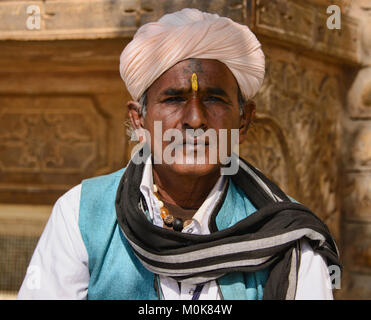 A man in his white turbans of Rajasthan, India - Stock Photo
