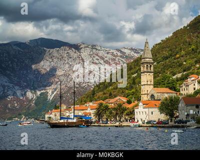 Buildings and boats along the Bay of Kotor; Perast, Kotor, Montenegro - Stock Photo