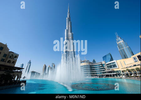 DUBAI, UNITED ARAB EMIRATES - JAN 02, 2018: Fountainshow in front of the Burj Khalifa in the center of Dubai, it - Stock Photo