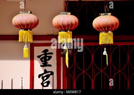A row of decorative red lanterns hanging in Chinatown to celebrate Chinese Lunar New Year in Singapore - Stock Photo