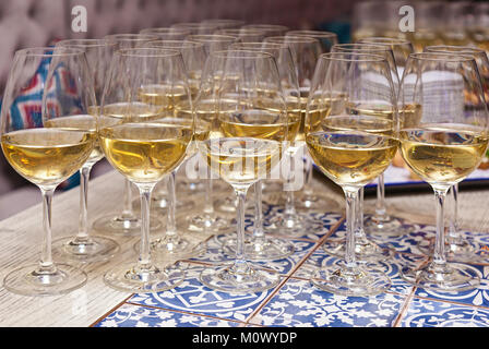 Glasses of champagne on the table. - Stock Photo
