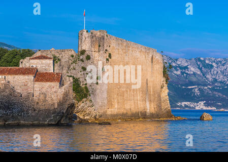 Walls of citadel on the Old Town of Budva city on the Adriatic Sea coast in Montenegro - Stock Photo