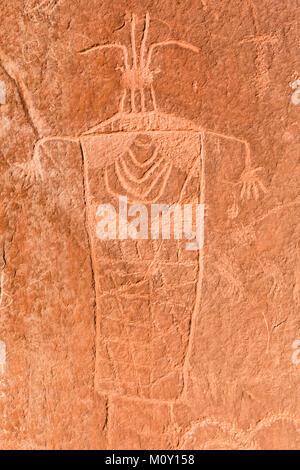 Pre-Columbian Anthropomorphic petrogyphs on the cliffs on the Escalante River Canyon in Grand Staircase Escalante - Stock Photo
