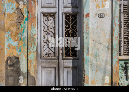 Old green, brown doors, buildings and streets in Santa Clara, Cuba.RW2 - Stock Photo