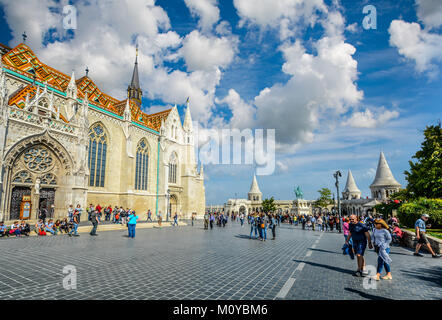 A sunny day at Castle hill complex in Budapest Hungary with Matthias Church and Fisherman's Bastion crowded with - Stock Photo