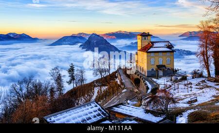Panoramic view of Lugano city, Lake Lugano and Monte San Salvatore from Monte Bre, Ticino, Switzerland, in winter - Stock Photo
