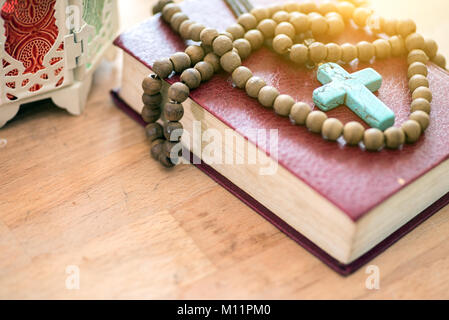 Holy Bible Closeup. Holy Bible on the Small Aged Wooden Table. - Stock Photo