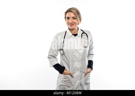 A female doctor in a gown and with stethoscope hanging on her neck is preparing for an injection - Stock Photo
